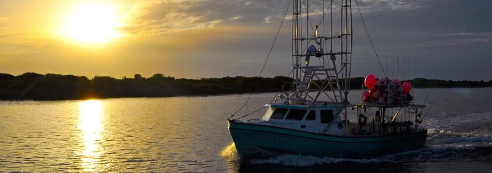 sunset fishing boat